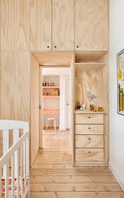 small inner city apartment uses plywood to enhance perception of