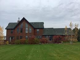 log cabin on deer lake next to boyne mountain boyne city