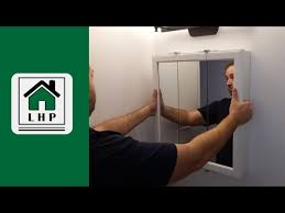 how to hang a medicine cabinet hanging a bathroom medicine cabinet lhp youtube