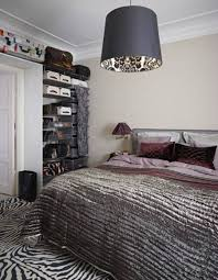 animal print bedroom ideas zebra area rug and black drum pendant