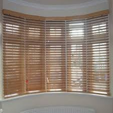 Wooden Blinds Nottingham 66mm Panel Curved Windows Full Height Panels With 89mm Slats With