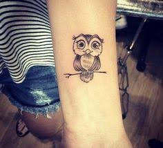 small owl design on ankle tattoos small