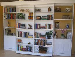 sliding bookcase murphy bed there is a double murphy bed behind the shelving the shelving