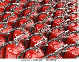 fire extinguishers total potection security background stock