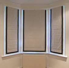 ivory roman blinds with contrast black inset borders 窗帘