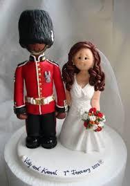bride and groom wearing biker helmet wedding cake by alittlerelic