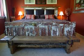 rustic queen size bed frame with reclaimed wooden door footboard