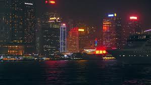 hong kong light show cruise hong kong skyline and light show at night seen from kowloon stock