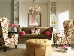 printed armchairs with brown sofa for classic living room interior