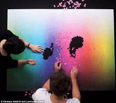 color spectrum puzzle time lapse video shows 5 000 piece jigsaw being completed daily