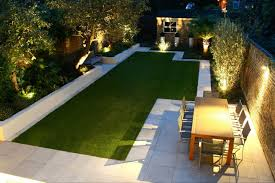 Backyard Landscape Lighting Ideas - modern backyard landscape house design with green grass in the