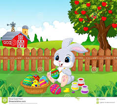 cute easter bunny cartoon painting an egg in the garden stock