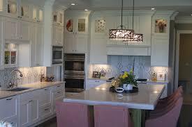 kitchen display cabinets kitchen with tile back splash zodiaq quartz countertops and upper