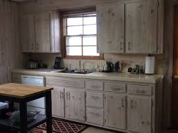 painting knotty pine kitchen cabinets white moderizing knotty pine kitchen need floor and counter help