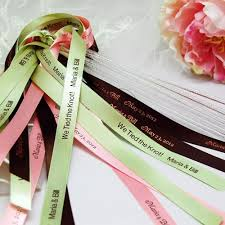 personalized ribbon for wedding favors wedding favor personalized ribbon wands a wedding cake