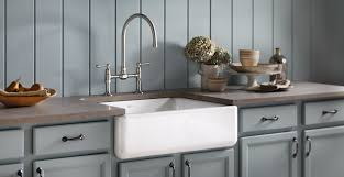white kitchen cabinets with farm sink sink options for your colorado kitchen lenova kohler