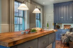 blue kitchen cabinets with wood countertops solid wood countertops a unique feature in your kitchen