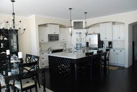 white kitchen with black island kitchen white cabinets black island and photos