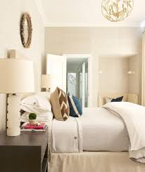 cream headboard and espresso stained nightstand with tassel