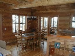 log cabin floors cedar log lake home set in hillside huisman concepts