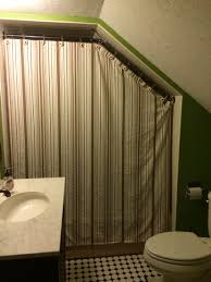 completed curtain rod with closed curtain sewed down the top of