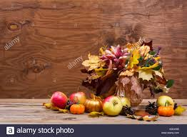 thanksgiving table centerpiece with fall leaves bouquet golden
