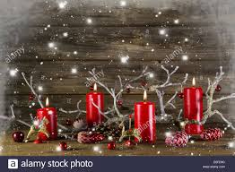 xmas decoration on wooden rustic background four red burning