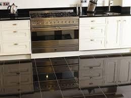 high gloss black granite tiles kitchen floor white kitchen cabinet