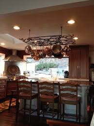 pot rack with lights homesfeed iron pot rack with lights with three stools and kitchen island