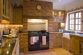 images kitchen with rustic cabinets brick black appliances
