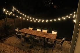 contemporary outdoor dining room with globe patio light strings