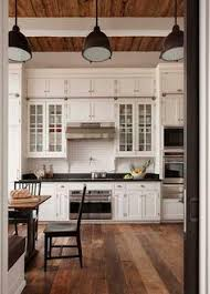 cheap kitchen cabinets and countertops white kitchen shaker cabinets hardwood floor black pulls for