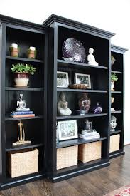 black bookshelf with cabinet trim three inexpensive bookcases with mouldings and paint them black