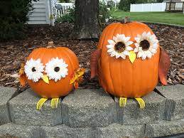 owl pumpkins with flower eyes and forks for feet halloween