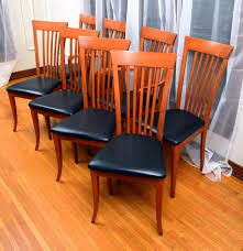 eight italian dining chairs by a sibau ebth