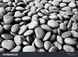 numerous small black stones fill ornamental stock photo 115842325