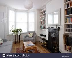 sitting room with bay window and fireplace residential house uk