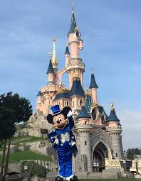 mickey near by the castle in his 25 anniversary at