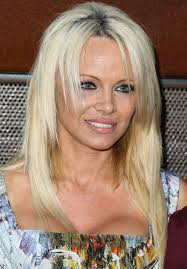 pamela anderson shows off her gorgeous grown up sons on the red