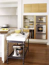 wrought iron kitchen island marble topped pastry table addition to island in better homes