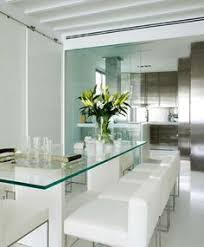 glass dining room sets surrounded by green dining room the garden outside and the floor to