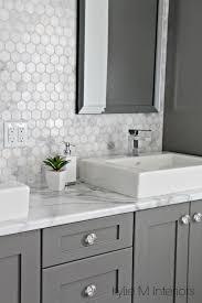 backsplash and chelse gray vanity in ensuite bathroom with raised