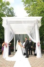 Pergola Wedding Decorations by Wedding Arbor Decor With Fabric And Flowers Rustic Elegant