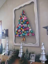 vintage ornament tree on a refurbished screen door so