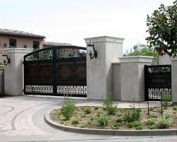 these garage doors in san diego were designed to complement the a wood and iron gate located in temecula ca designed built and installed