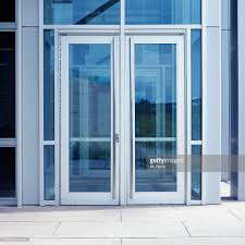 Entrance Doors by Office Building With Glass Entrance Doors Stock Photo Getty Images