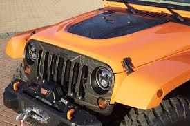 jeep wrangler orange and black jeep unveils wrangler grand cherokee cherokee concepts in moab