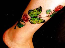 lovely red rose flower with beautiful green butterfly tattoo make