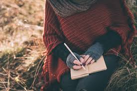 Woman writing in the notebook eHarmony
