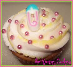 baby shower cupcake with pink pearls and a edible baby pin baby